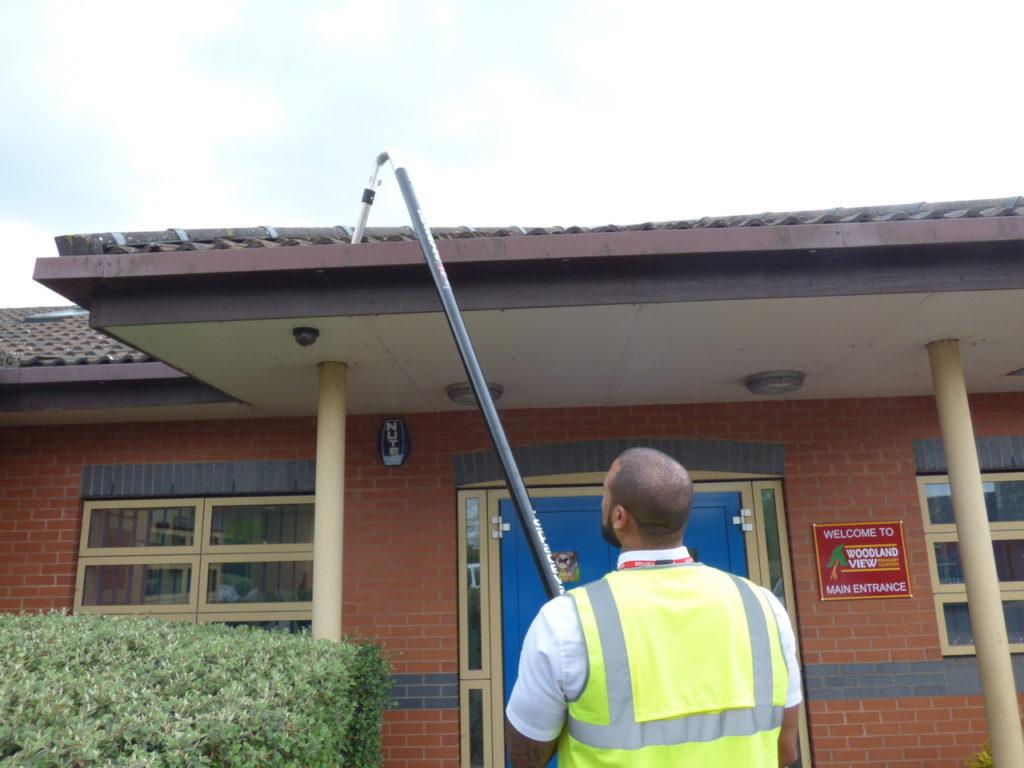 Gutter cleaning with SpaceVac external high reach gutter vacuum - 5